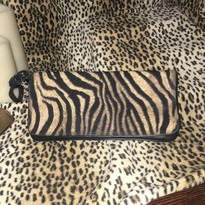 Brown zebra wristlet clutch